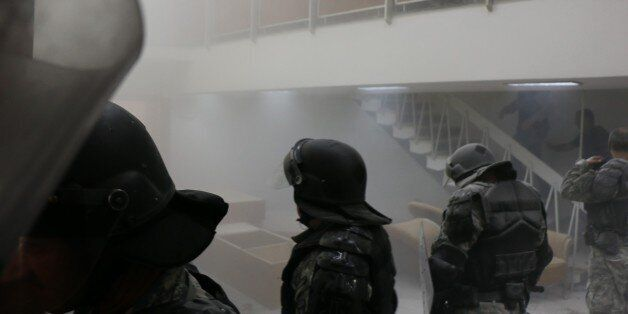 SKOPJE, MACEDONIA - APRIL 27: Police use tear gas to the protesters demonstrate inside the parliament...
