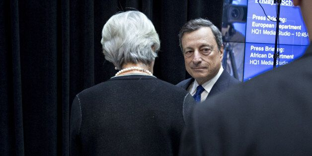 Mario Draghi, president of the European Central Bank (ECB), center, stands next to Christine Lagarde,...