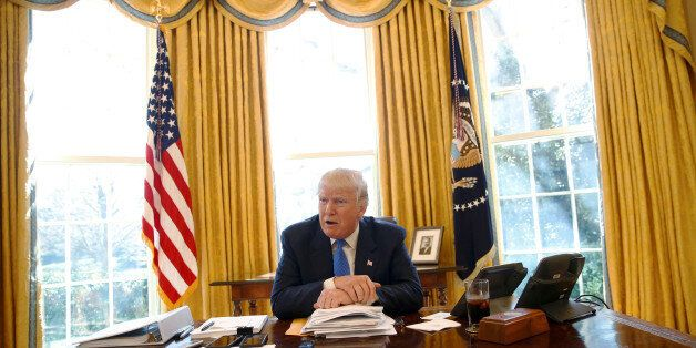 U.S. President Donald Trump gives an interview from his desk in the Oval Office at the White House in...
