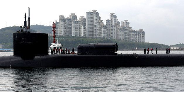 The Ohio-class guided-missile submarine USS Michigan arrives for a regularly scheduled port visit while...