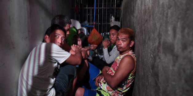 MANILA, PHILIPPINES - APRIL 27: Alleged drug suspects detained at a small secret cell behind a wooden...
