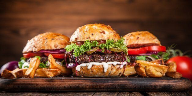 Delicious hamburgers on wooden