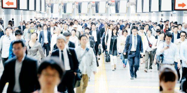 A busy pedestrian walkway, businessmen and women, Tokyo. Daytime, interior, horizontal composition. Business,...