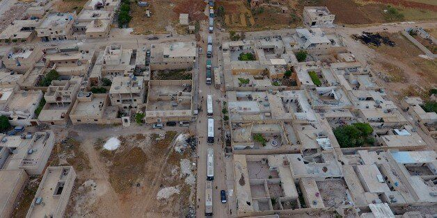ALEPPO, SYRIA - MAY 5 : Buses carry Syrian civilians and opponent forces members, evacuated from Al-Waer...