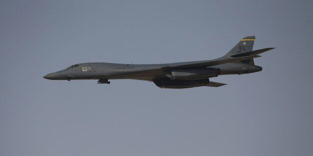 A Rockwell B-1 Lancer bomber performs a flypast on the opening day of the 14th Dubai Air Show at Dubai...