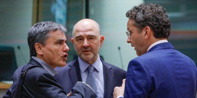 Greek Finance Minister Euclid Tsakalotos (L), European Economic and Financial Affairs Commissioner Pierre...