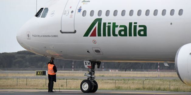The Alitalia plane transporting Pope Francis for a two-days visit in Egypt prepares to take-off on April...