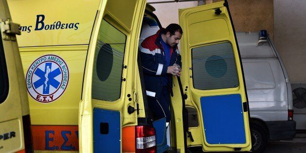 TO GO WITH AFP STORY BY SOPHIE MAKRIS A paramedic exits an ambulance outside a hospital on the eastern...