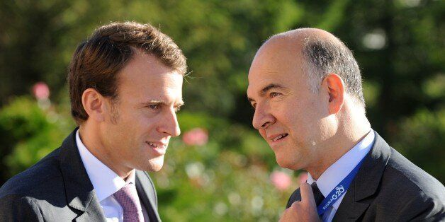 French President's deputy General Secretary Emmanuel Macron (L) and French Economy, Finance and Foreign...