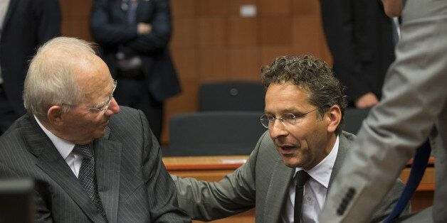 Wolfgang Schauble, Germany's finance minister, left, speaks with Jeroen Dijsselbloem, Dutch finance minister...