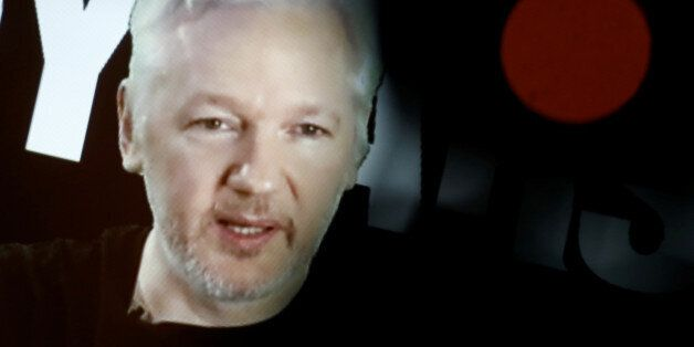 Julian Assange, Founder and Editor-in-Chief of WikiLeaks speaks via video link during a press conference...