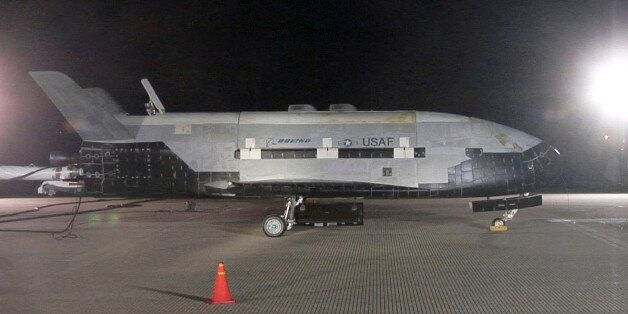 The X-37B Orbital Test Vehicle sits on the runway during post-landing operations Dec. 3, 2010, at Vandenberg...