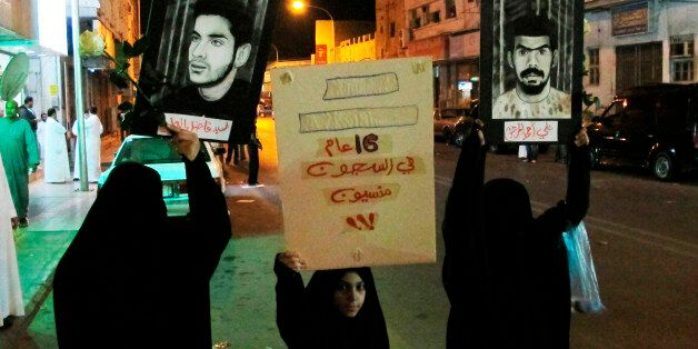 Protesters hold posters of prisoners during a protest in Qatif March 9, 2011. Saudi Shi'ites staged another...