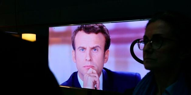 French presidential election candidate for the En Marche ! movement Emmanuel Macron is pictured on a...
