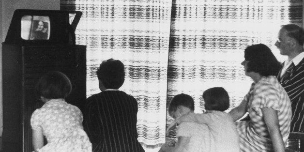UNITED KINGDOM - FEBRUARY 23: A family watching a television broadcast, c 1930s. Photograph showing a...