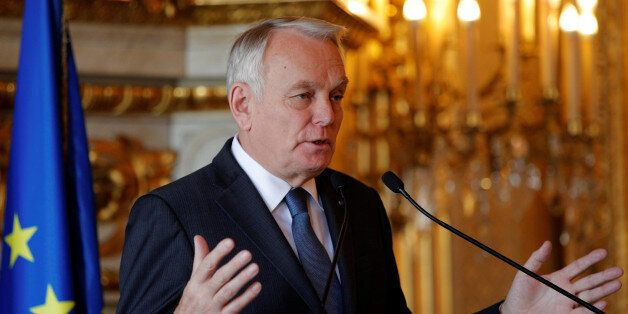 French Foreign Minister Jean-Marc Ayrault delivers his speech during a press conference in Paris, France,...