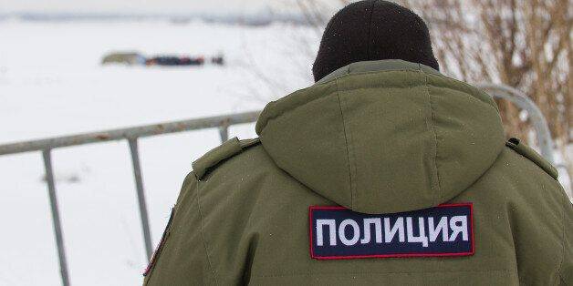 Russian police - emblem on the back OMON, close up at winter