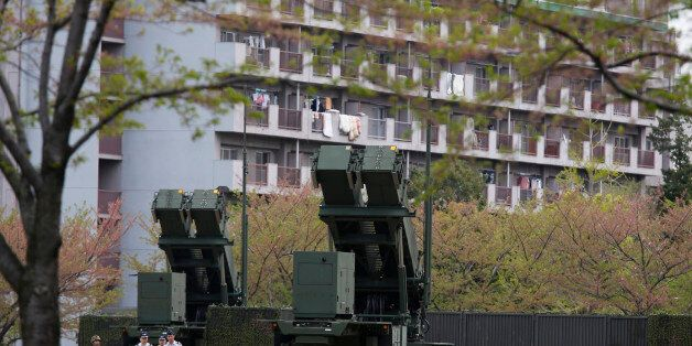 Units of Patriot Advanced Capability-3 (PAC-3) missiles stand in front of a housing complex, at the Defence...