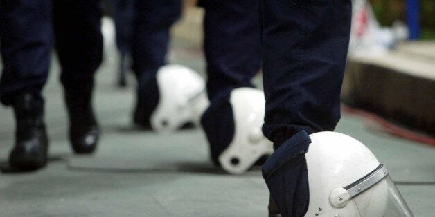 Turkish police helmets lie on the ground as the Turkey v England European Championships qualifying match...