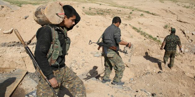 A member of the Sinjar Resistance Units (YBS), a militia affiliated with the Kurdistan Workers' Party...