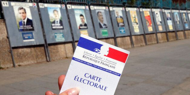 PARIS, FRANCE - APRIL 20: In this photo illustration, a French voter registration card is seen in front...