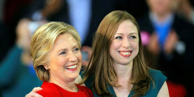 Democratic presidential nominee Hillary Clinton shares a hug with her daughter Chelsea Clinton at a campaign...