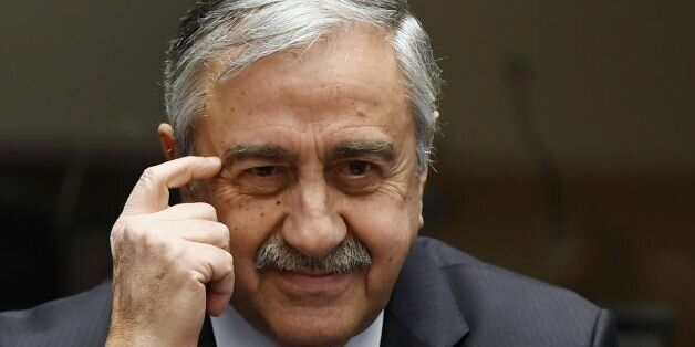 Turkish Cypriot leader Mustafa Akinci gestures during a press conference on UN-sponsored Cyprus peace...