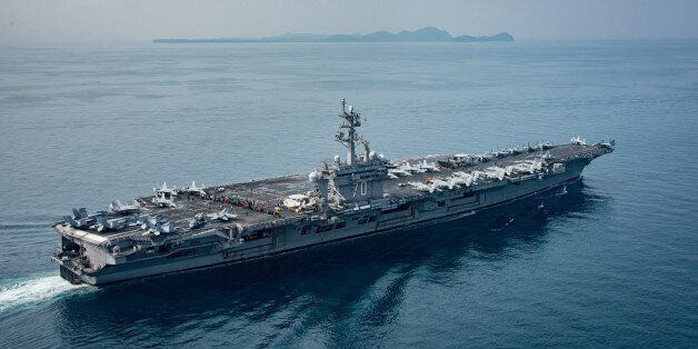 SUNDA STRAIT, INDONESIA - APRIL 14: In this handout provided by the U.S. Navy, the aircraft carrier USS...