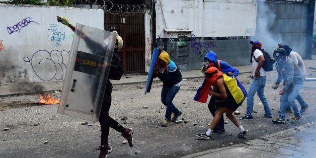 Demonstrators clash with the police during a rally against Venezuelan President Nicolas Maduro, in Caracas...