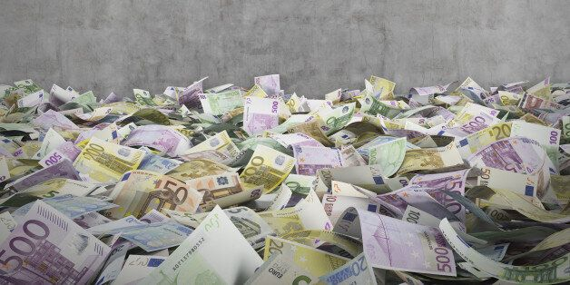 euro banknotes on a conctere wall