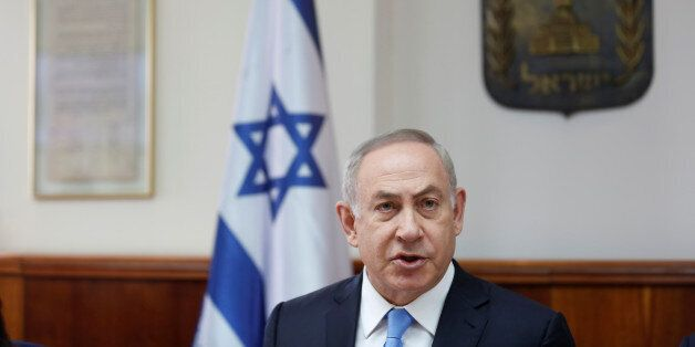 Israeli Prime Minister Benjamin Netanyahu attends the weekly cabinet meeting in Jerusalem, April 23,...