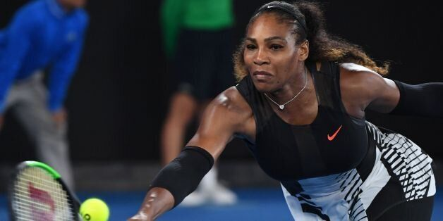 Serena Williams of the US hits a return against Venus Williams of the US during the women's singles final...
