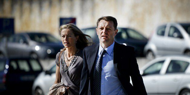 Britons Kate McCann (L) and her husband Gerry McCann (C), parents of missing British girl Madeleine McCann,...