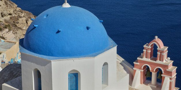Blue dome of a church overlooking the Aegean Sea from Santorini Island, Greece. (Photo by Creative Touch...