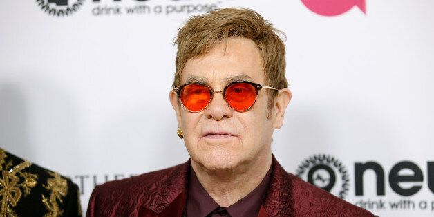 Singer Elton poses at his 70th Birthday and 50-Year Songwriting Partnership with Bernie Taupin event,...
