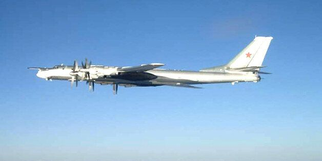 In this U.S. Navy handout, one of two Russian Tu-95 Bear long rang bomber aircraft is shown flying near...