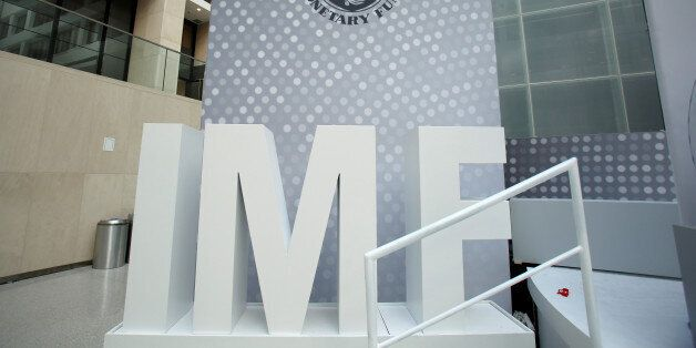 International Monetary Fund logo is seen inside the headquarters at the end of the IMF/World Bank annual...