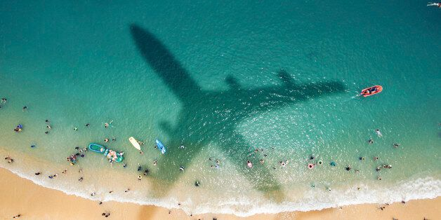 Airplane's shadow over a crowded