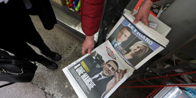 Copies of French daily newspapers with front pages about the results in France's Presidential election...