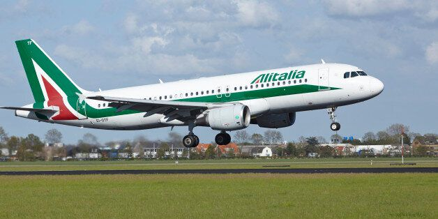Amsterdam, The Netherlands - May 7, 2015: An Airbus A320-216 of Alitalia lands at Amsterdam Airport Schiphol...