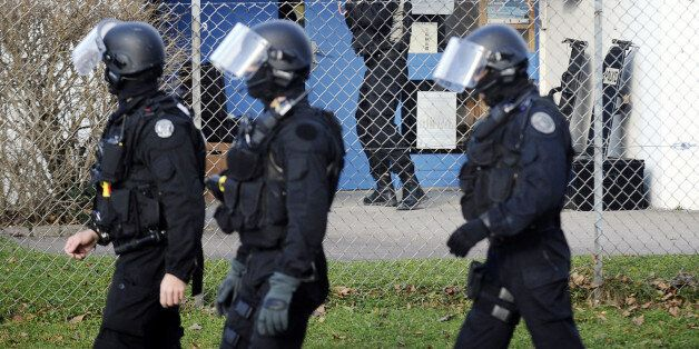 Members of French National Police Intervention Groups forces (GIPN) get ready near a nursery school where...