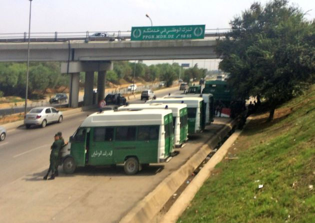 A picture taken on September 20, 2019 shows police vehicles blocking one of the main roads leading to...