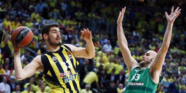 ISTANBUL, TURKEY - APRIL 25: Nikola Kalinic,Ê#33 of Fenerbahce Istanbul competes with Nick Calathes,...