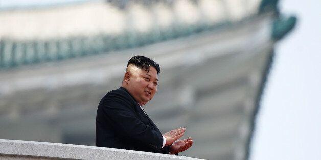 North Korean leader Kim Jong Un applauds during a military parade marking the 105th birth anniversary...