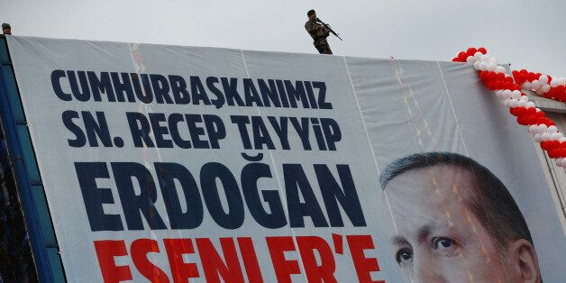 Turkish police officers stand guard during a rally of the pro-Kurdish opposition Peoples' Democratic...