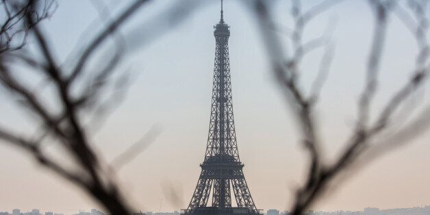 The Eiffel Tower stands as residential and commercial properties sit on the city skyline in Paris, France,...