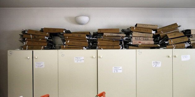 Tax archives are seen piled up inside a tax office in Athens, Greece, June 25, 2015. Monthly reports...