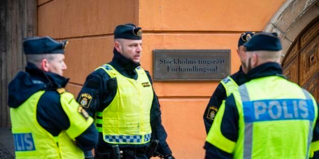 Policemen secure the entrance to the Stockholm District Court where Uzbek national Rakhmat Akilov (not...