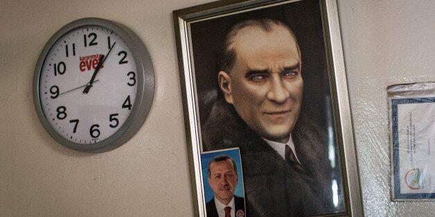 ISTANBUL, TURKEY - APRIL 16: Portraits of Mustafa Kemal Ataturk and Turkish President Recep Tayyip Erdogan...
