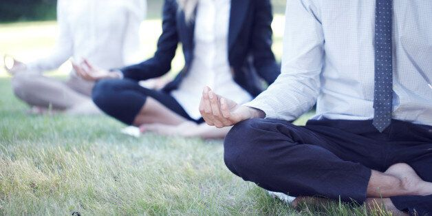 Business people practicing yoga in